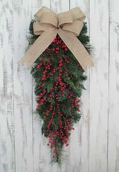 Red Berry Christmas Teardrop Wreath. Perfect for winter and Christmas home and door decor, and gifts. Seasonal. Limited quantity available. - Decorative red berries - Natural burlap bow - Created on a