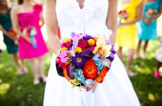 Multi-colored bouquet and bridesmaid dresses