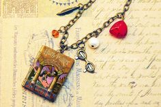 Sorcerer's Stone - a miniature book locket necklace inspired by Harry Potter book 1. $20.00, via Etsy.