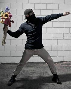 """Flower Molotov by Banksy  """"Give love, its worth a riot""""  Human Graffiti Recreations"""