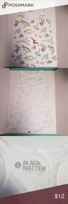 Juniors Black Matter Hot Topic Dinosaur Tanktop L NWOT juniors sized dinosaur tank top in a size large. Orginally brought from hot topic but no longer fits me. Never worn it and i lost the tag. By the brand Black Matter. The tanktop is soft and very cute. Great for summer and under jackets. The fit is smaller because it is a juniors large not a womens. Hot Topic Tops Tank Tops