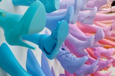 Dutch designer John Breed created this leggy installation for Breuninger's newly opened shoe salon in Stuttgart, Germany. The vibrant and playful piece is made up of a rainbow of 145 fiberglass legs and shoes, cascading across the store's wall. Serious eye candy for any shoe lover!