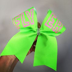 Neon FLYER Cheer Bow green and pink hair bow ($14) ❤ liked on Polyvore featuring accessories, hair accessories, cheer, pink hair bow, neon hair accessories, green hair accessories, hair bow and glitter hair accessories
