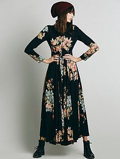 First Kiss Dress | Long-sleeved floral printed maxi. Button back closure and keyhole opening at top of back. Skirt portion is lined.