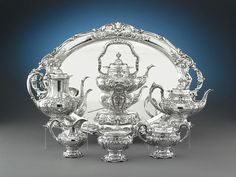 This outstanding, seven-piece silver coffee and tea service is crafted by the renowned silversmiths Reed