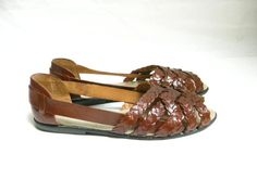 Vintage  Brown Leather Woven Leather Peep Toe Huarache Flats. Size  8 1/2. $34.00, via Etsy.