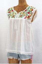 this website has a bunch of pretty embroidered Mexican Peasant Tops and Blouses and their so cute and fashionable and stylish :)