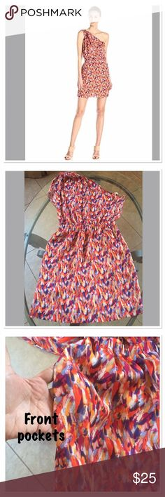 BCBG dress NWOT Adorable orange multi color one shoulder dress.  It has front pockets and an elastic waist band .  New with out tags. BCBGeneration Dresses Mini
