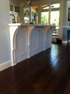 Custom corbels supporting a special island in a special kitchen. By Harlow Woodworks of Austin, TX
