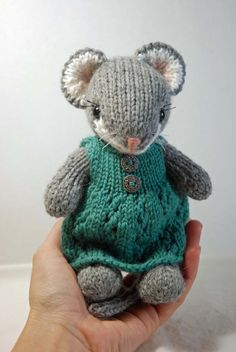 This listing is for a tiny hand knit mouse who measures approx. 7 tall and fits into the palm of your hand! The mousie and her dress are knit with 100% wool - the little dress is knit in a pretty blue/green color and has 2 small decorative metal buttons on the front and a small button at the shoulder so the it can be put on and removed easily. She is a much smaller version of my usual sized animals and is perfect for little hands. The little mouses limbs have been thread jointed and are…