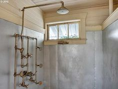 1910 Craftsman – Saint Helens, OR. Old shower fixture from the 1920's..? Look at the tin walls, how interesting.
