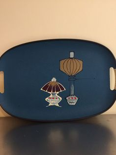 A personal favorite from my Etsy shop https://www.etsy.com/listing/287325687/mid-century-fiberglass-serving-tray