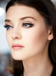 The Retro Statement Eyes | Double winged black cat eye #makeup with thick lashes and neutral glossy lips. Christian Dior Cruise 2015 #Resort2015