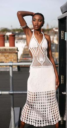Ianthe - Here is a daring sundress with a horizontal accent, a very revealing back, and shoulders that will be remembered long after you've dashed off to that dinner date. - http://www.chotikadesigns.co.uk/crochet/ianthe/