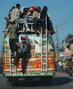 """Haiti - Transportation - Tap-Tap When we asked our translator how many people can fit in a tap tap, his responses was """"there is always room for one more""""."""