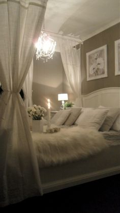 OMG..I was meant to sleep like this!! A chandelier over the bed...now THAT is an idea!!