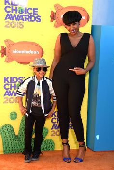 Jennifer Hudson in a black jumsuit, with her son, David
