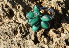 little pieces of malachite holding each other with iron wire - they used to be part of an old beautiful necklace which was ruined, these little guys are the survivors... --- χάντρες από μαλαχίτη δεμένες με σύρμα - ήταν από παλιό κολιέ που χάλασε, ευτυχώς απέμειναν κάποια κομμάτια...