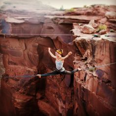 Liz Thomas doing the splits on a Highline in Moab Utah  It was so beautiful there! Great times all around!
