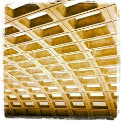"""taken at Metro Center Metro station, DC. DC Metro station design comes from architect Harry Weese (Chicago?). This is the ceiling design, and it's part of a post-modern genre called """"Brutalist"""" (exposed concrete, etc). my dad took my brother and i on a ride opening day (1976?) and to me the ceilings were the most fascinating part of the experience. i still look up and admire them, possibly to escape the new realities of using Metro :)"""