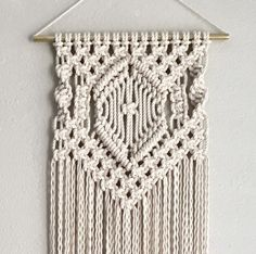 Macrame Wall Hanging Pattern Pattern Name - Center Diamond Buy 4 DIY Macrame Patterns and get one $4.99 pattern free using Coupon Code: Macrame This is a digital download pattern/DIY for a Macrame Wall Hanging that I designed. It list the materials needed as well as a written