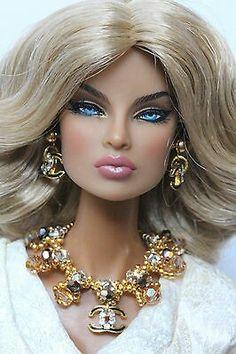 Poppy Parker Doll wearing Chanel Jewelry from EBay.