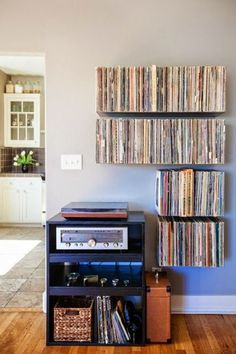 B L O O D A N D C H A M P A G N E » INTERIORS Jesse designed these floating record shelves and then our good friend Mike Zimmerer of Zimm Metalworks built them. Jesse also built the stereo cabinet.