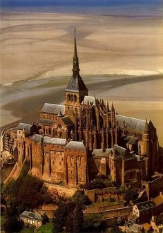 Mont St. Michel, France is named after the arch-angel St. Michael. It is known as the Merveille de l'Occident or Wonder of the Western World. The granite used to build the abbey was transported by boat from the nearby Isles of Chausey. Construction of the original abbey took more than 500 years, from 1017 to 1521