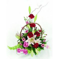 Rose, Carnations & Lillies in a basket arrangement