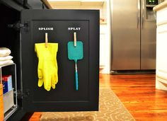 Cool way to use clothespins to store under sink tools