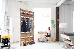 I like how they used the crates in their studio home in San Francisco to not only create and entry space, but also as a shoe and coat rack.