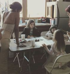 Kat Graham and the triplets (Tiercey plays Josie, and Lily Rose plays Lizzie) . Miley is the third one, she's very supportive, always on the set with her sisters.