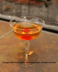 Preakness Manhattan  1-1/2 ounce Bourbon  1/4 ounce Brandy  1/2 ounce Benedictine  1/2 ounce Sweet Vermouth  3 dashes Angostura Bitters  Lemon Twist Garnish