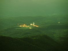 """This photograph depicts a classified """"listening station""""deep in the forests of West Virginia. The station is located at the center of the """"National Radio Quiet Zone,"""" a region of approximately 34,000 square kilometres in West Virginia and parts of Maryland. Within the Quiet Zone, radio transmissions are severely restricted: omnidirectional and high-powered transmissions (such as wireless internet devices and FM radio stations) are not permitted."""
