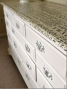 Tutorial on refurbishing furniture using wrapping paper & mod podge for the top.