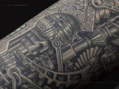 Greyed ink biomechanical tattoo.