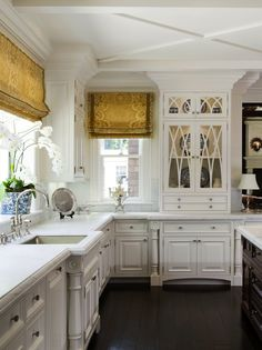 Classic white kitchen with Roman shades, orchid, blue and white porcelain - Pacific Peninsula Group
