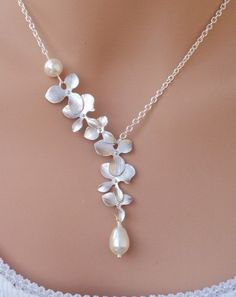 Sanari - Silver Matte Orchids and Swarovski Pearl sterling silver necklace. $32.00, via Etsy.