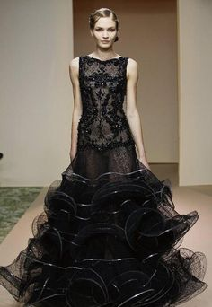 Dany Atrache Haute Couture 2012.    I love how the designer maintained the shape of the ruffles and tiers to give the look of waviness in the skirt of this gown!!!