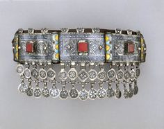 Woman's Headpiece.  Ida ou Nadif people | Mid 19th ot early 20th century.  Silver, enamel, glass and leather | Jewelry is important to the whole Berber family. It is the husband who buys the jewelry for his wife and it serves as a social emblem identifying prestige and class. In times of financial trouble, the husband may choose to sell it to supplement income. Jewelry has spiritual meaning as well.