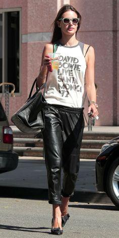 Baggy black leather pants & stilettos