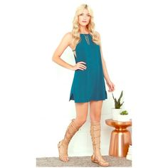 On the fly teal blue dress Feel the wind beneath your wings as your style takes flight in the On the Fly Teal Blue Dress! Breezy, woven fabric shapes a high apron neckline, then flows into a relaxed-fit bodice with darting at the sides. Wide arm openings are accented with a horizon Lulu's Dresses Mini