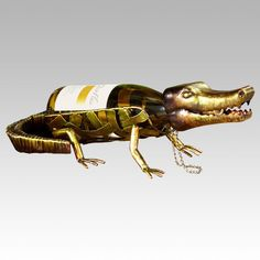 AtopTheTable.com - Sculptured Snapping Alligator Metal Wine Bottle Holder by Deco Flair, $36.94 (http://atopthetable.com/sculptured-snapping-alligator-metal-wine-bottle-holder-by-deco-flair/)