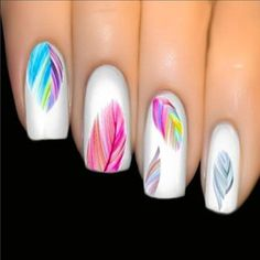 white nails colourful feathers