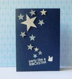 handmade card ... navy blue base card with punched glittery stars ... luv the strong graphic effect of the card base with strong lines in the stars ... great card for a teen boy ...
