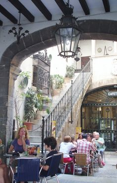 Sit in the shade of a Palma (Spain) cafe and watch the world go by ...