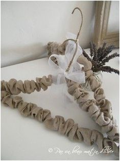 burlap covered hangers ~ helpful hint: if you want the burlap to be softer, wash and dry it a few times before using this way