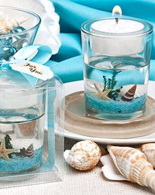 Stunning  beach-themed candle favor.  You could do this for any party favor!! Flowers in the bottom for a bridal shower, diamonds, beer bottle caps, baby shower theme.  CUTE!