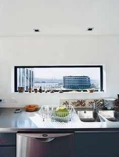 Over the Bieringas' kitchen sink, a sliver of a window provides a peek at the newly created Waitangi Park on the revitalized Wellington Harbor.