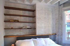 Built-in walnut shelving and headboard.